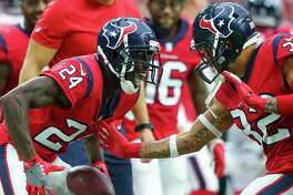 Houston Texans cornerback Johnathan Joseph (24) celebrates with free safety Tyrann Mathieu (32) after returning an interception for the winning touchdown during the fourth quarter of an NFL game against the Buffalo Bills at NRG Stadium Sunday, Oct. 14, 2018, in Houston. The Texans won 20-13.