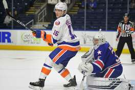 Kieffer Bellows of the Sound Tigers screens Americans goalie Adam Wilcox during the first period of Sunday's game at the Webster Bank Arena in Bridgeport.
