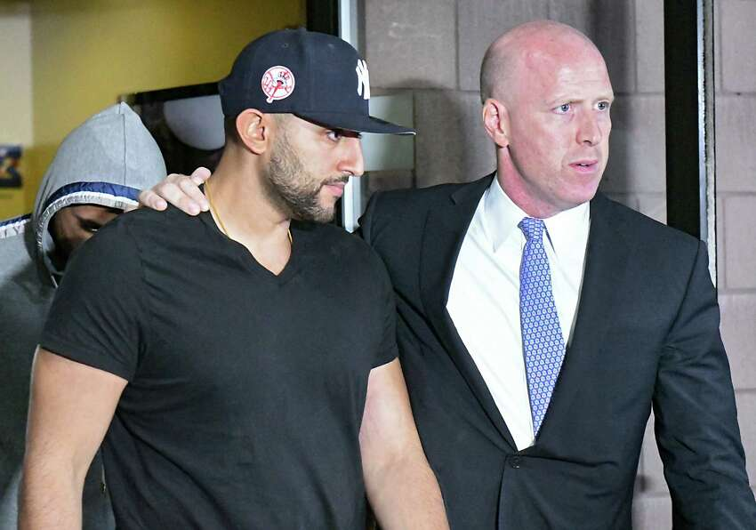 Nauman Hussain, operator of Prestige Limousine, left, leaves his arraignment at Cobleskill Town Court with his attorney Lee Kindlon for his involvement in the Schoharie limo crash on Wednesday, Oct. 10, 2018 in Cobleskill, N.Y. (Lori Van Buren/Times Union)