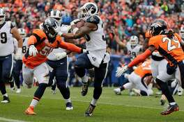Los Angeles Rams running back Todd Gurley (30) keeps his hand on Denver Broncos linebacker Todd Davis (51) as he scores on a 4th and 1 play from the 10 yard line in the second quarter on Sunday, Oct. 14, 2018 at Broncos Stadium at Mile High in Denver, Colo. (Gina Ferazzi/Los Angeles Times/TNS)