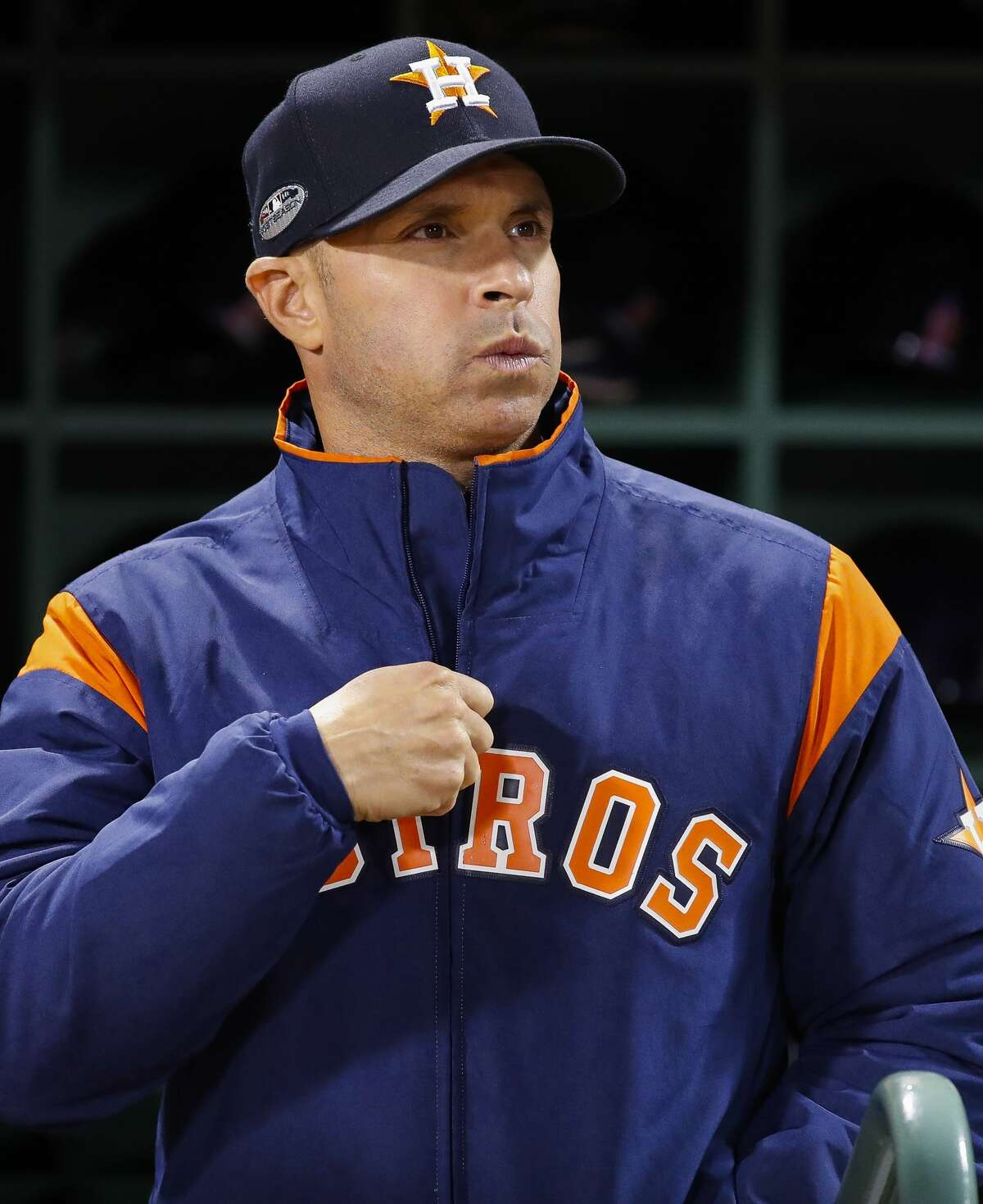Houston Astros bench coach Joe Espada (20) prepares for the start of Game 2 of the American League Championship Series at Fenway Park on Sunday, Oct. 14, 2018, in Boston.