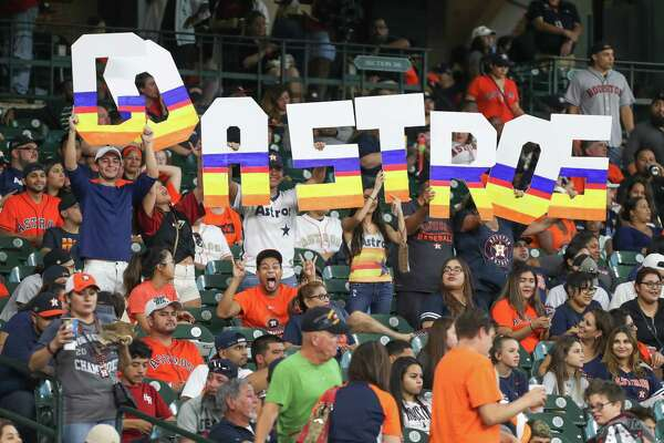 Houston Astros fans react to action in the first inning of game two of the American League Championship series inside Minute Maid Park Sunday, Oct. 14, 2018, in Houston.