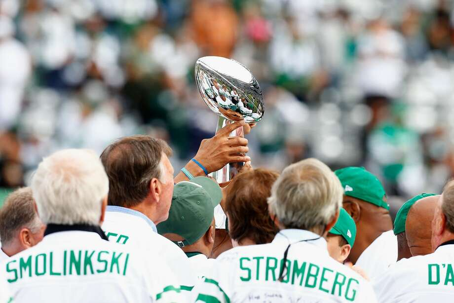 EAST RUTHERFORD, NJ - OCTOBER 14:  Members of the Super Bowl III New York Jets team celebrate with the Vince Lombardi trophy during a 50th Anniversary celebration held at halftime of the game between the New York Jets and the Indianapolis Colts at MetLife Stadium on October 14, 2018 in East Rutherford, New Jersey.  (Photo by Mike Stobe/Getty Images) Photo: Mike Stobe, Getty Images