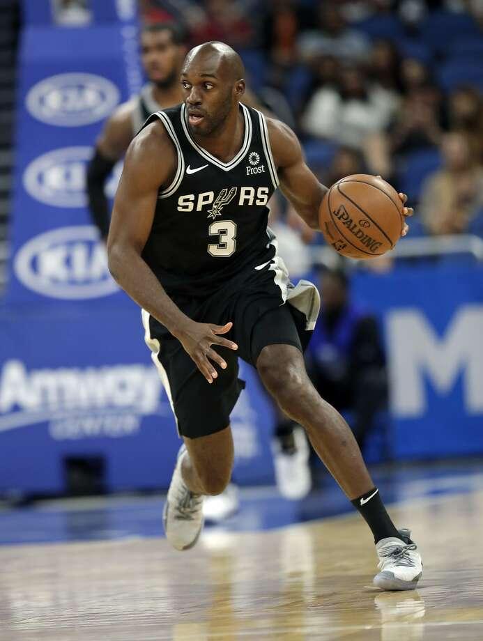San Antonio Spurs forward Quincy Pondexter (3) moves the ball against the Orlando Magic during the second half of an NBA preseason basketball game, Friday, Oct. 12, 2018, in Orlando, Fla. (AP Photo/John Raoux) Photo: John Raoux, Associated Press