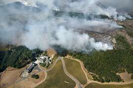 The Atlas fire burns near the Kenzo Estate winery in Napa, Calif., on Monday, October, 9, 2017.