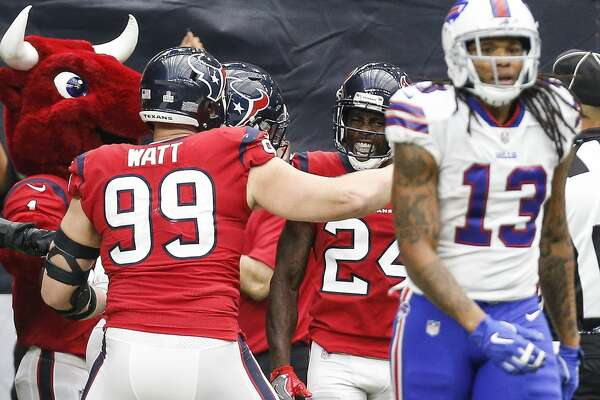 Houston Texans cornerback Johnathan Joseph (24) celebrates after returning an interception for a touchdown during the fourth quarter as the Houston Texans take on the Buffalo Bills at NRG Stadium Sunday Oct. 14, 2018 in Houston.