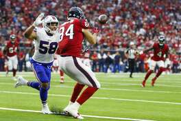 Buffalo Bills linebacker Matt Milano (58) breaks up an end zone pass to Houston Texans tight end Ryan Griffin (84) during the fourth quarter as the Houston Texans take on the Buffalo Bills at NRG Stadium Sunday Oct. 14, 2018 in Houston.
