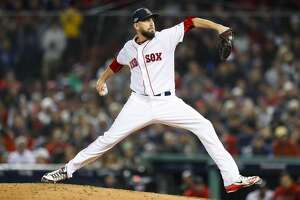 Boston Red Sox pitcher Matt Barnes pitches during the sixth inning of Game 2 of the American League Championship Series at Fenway Park on Sunday, Oct. 14, 2018, in Boston.