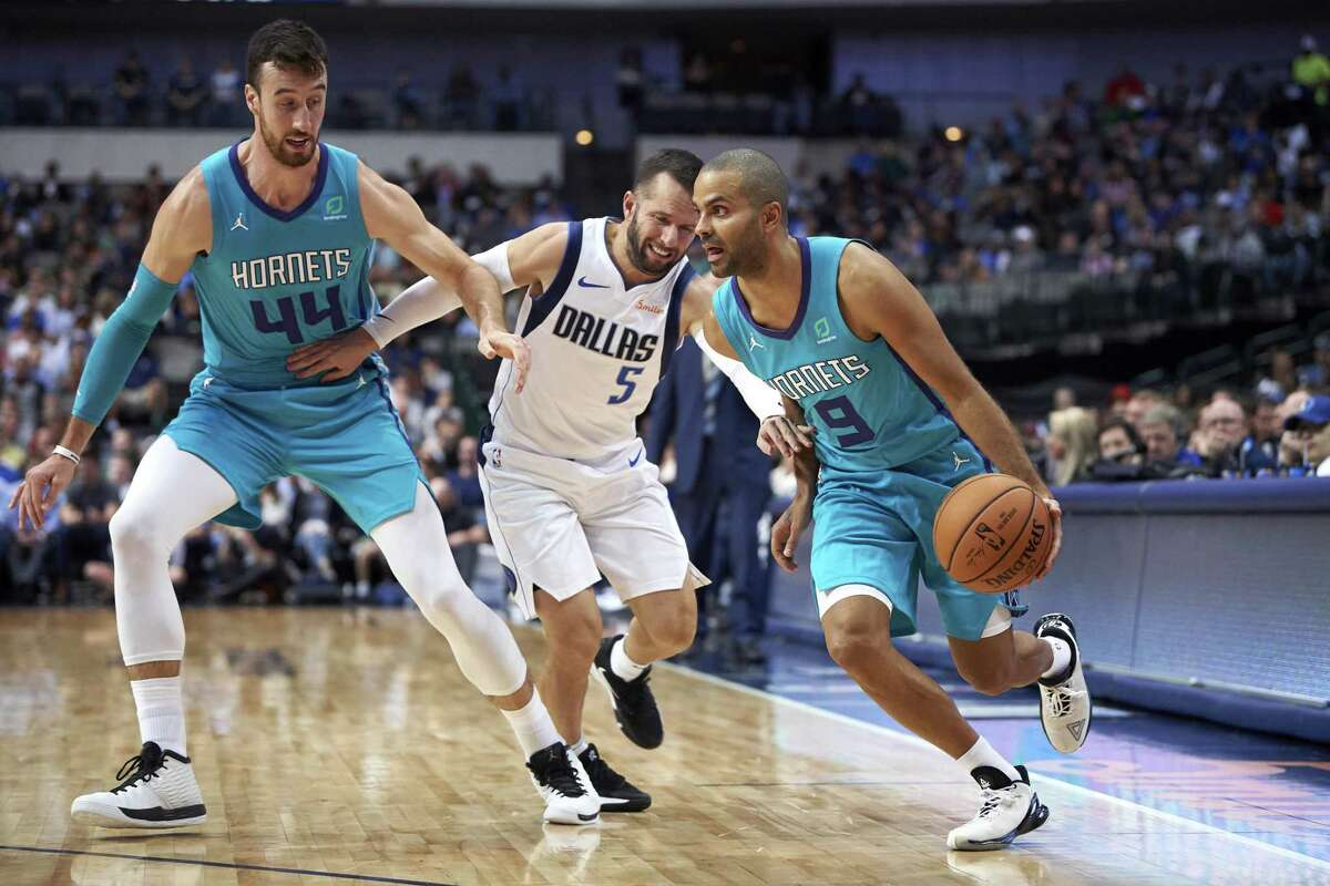Charlotte Hornets' Tony Parker (9) drives to the basket around a screen by teammate Frank Kaminsky (44) on Dallas Mavericks' J.J. Barea (5) during the second half of an NBA preseason basketball game Friday, Oct. 12, 2018, in Dallas. (AP Photo/Cooper Neill)