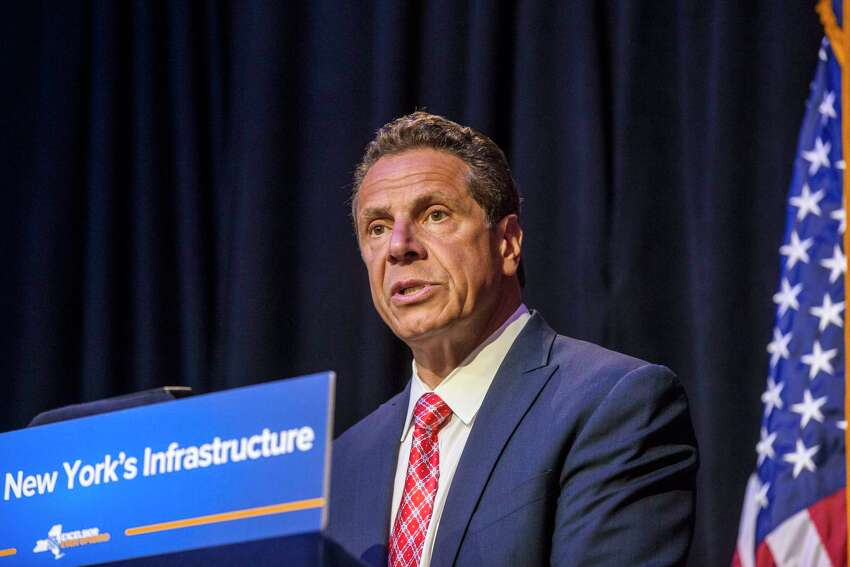FILE -- New York Gov. Andrew Cuomo talks about improvement plans for Penn Station and the subway system at the City University of New York, in New York, May 23, 2017. Cuomo will make a rare trip to Washington on Wednesday, July 26, 2017, to meet with Democratic members of the New York congressional delegation and the transportation secretary, Elaine Chao, as New York City suffers through an ongoing transit crisis. (Hiroko Masuike/The New York Times) ORG XMIT: XNYT182