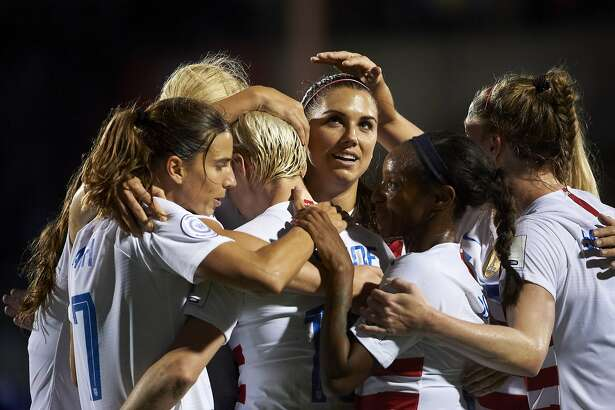 FRISCO, TX - OCTOBER 14: Alex Morgan #13 of the United States celebrates after scoring a goal against Jamaica during the first half of the CONCACAF Women's Championship semi-finals on October 14, 2018 in Frisco, Texas. (Photo by Cooper Neill/Getty Images)