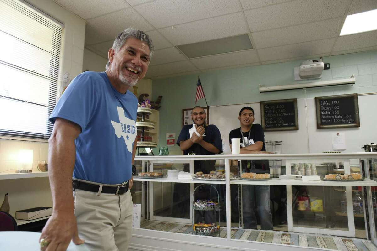 Special education teacher Ric Castillo shares a laugh with students Celestino Cervantes, middle, and Justin Avila at the student-run cafe at the Burleson Center for Education and Innovation on Sept. 28, 2018.