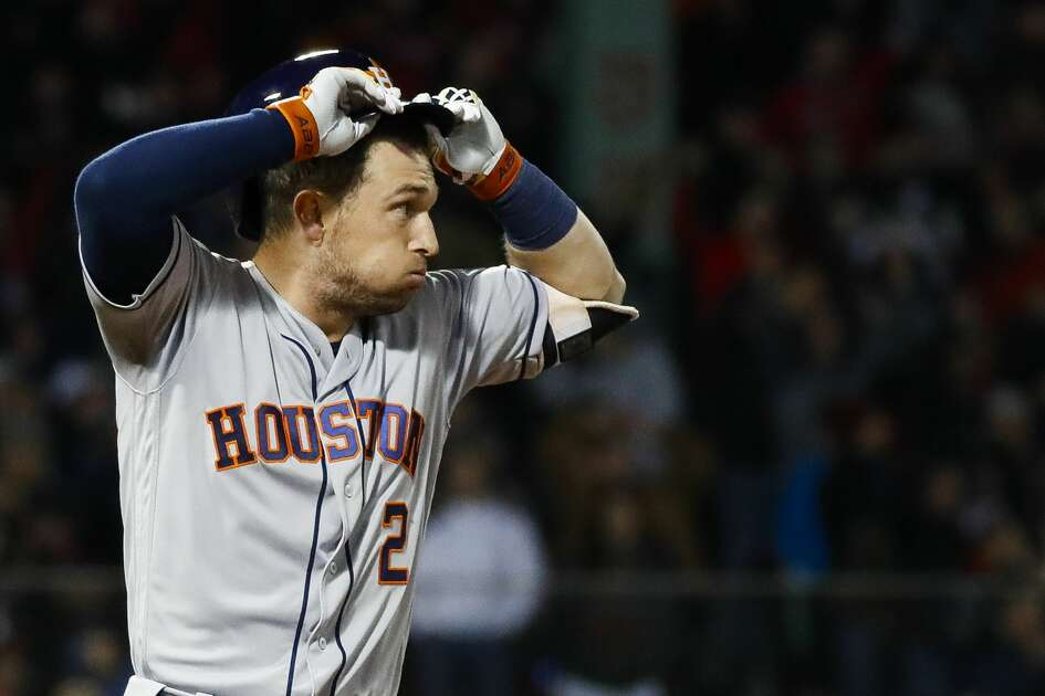 Houston Astros third baseman Alex Bregman (2) reacts as a flies out to left field to end the ninth inning of Game 2 of the American League Championship Series at Fenway Park on Sunday, Oct. 14, 2018, in Boston.