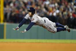 Houston Astros George Springer (4) slides into second base on a two-out double during the ninth inning of Game 2 of the American League Championship Series at Fenway Park on Sunday, Oct. 14, 2018, in Boston.