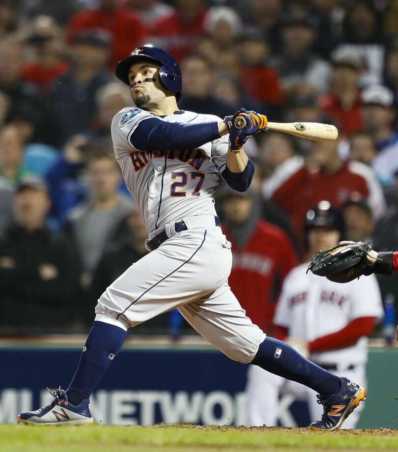 Houston Astros second baseman Jose Altuve (27) hits a RBI single during the ninth inning of Game 2 of the American League Championship Series at Fenway Park on Sunday, Oct. 14, 2018, in Boston. Photo: Brett Coomer/Staff Photographer