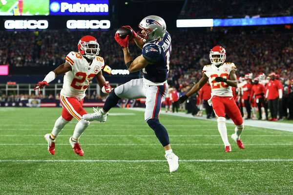 FOXBOROUGH, MA - OCTOBER 14: Julian Edelman #11 of the New England Patriots catches a pass for a touchdown in the second quarter of a game against the Kansas City Chiefs at Gillette Stadium on October 14, 2018 in Foxborough, Massachusetts. (Photo by Adam Glanzman/Getty Images)