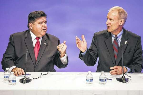 Republican Gov. Bruce Rauner (right) and his Democratic challenger, J.B. Pritzker, face off in a debate in Chicago. Republicans who gained ground in the Illinois General Assembly two years ago with Rauner's financial help face a tougher go of it this year. Rauner and his top contributors poured more than $40 million into legislative races in 2016. The GOP picked up seats in the House and Senate. Rauner hoped for further gains in 2018, but he's struggling in a re-election bid against Pritzker.
