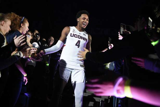 Connecticut's Jalen Adams (4) is greeted by fans as he is introduced during UConn's men's and women's NCAA college basketball teams' annual First Night celebration in Storrs, Conn., Friday, Oct. 12, 2018. (AP Photo/Jessica Hill)
