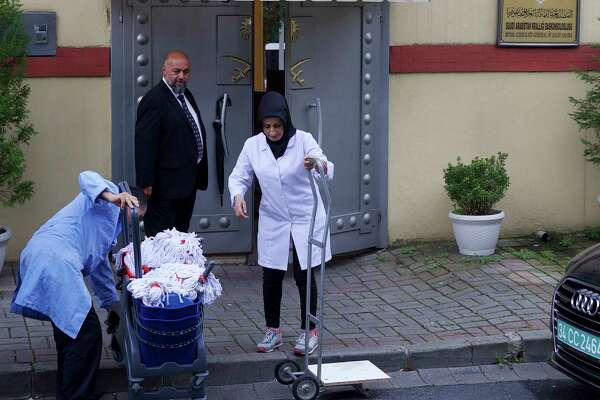 "Cleaning personnel enter Saudi Arabia's Consulate in Istanbul, Monday, Oct. 15, 2018. Turkey says an ""inspection"" of the consulate is expected to take place later on Monday, nearly two weeks after Saudi journalist after Jamal Khashoggi disappeared there."