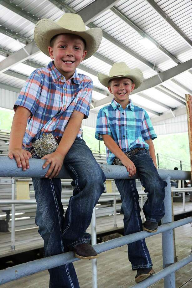 Tanner and Dawson Lott, twins of Allen and Heather Lott, when they were both third graders at Stephen F. Austin Elementary in Dayton ISD and enjoying the rodeo. Photo: David Taylor / HCN