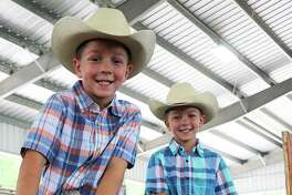 Tanner and Dawson Lott, twins of Allen and Heather Lott, when they were both third graders at Stephen F. Austin Elementary in Dayton ISD and enjoying the rodeo.