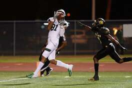 Nathaniel Beal (81) of Strake Jesuit makes a touchdown reception in the third quarter of a high school football game between the Strake Jesuit Crusaders and the Hastings Bears on Friday, Oct. 12, at Crump Stadium in Alief.