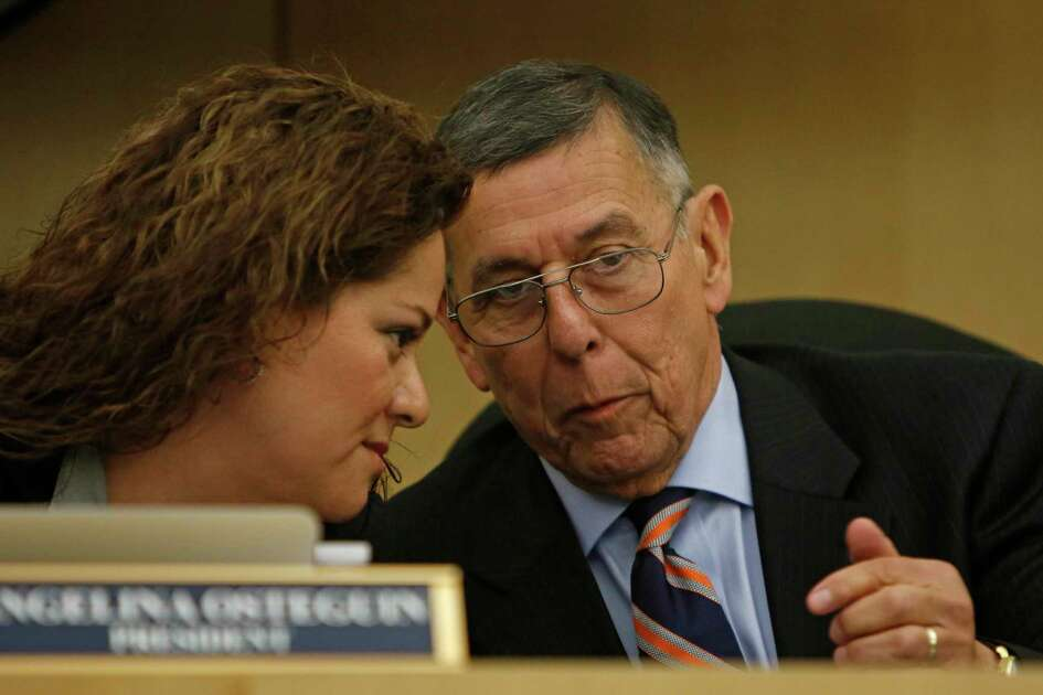 Former South San Antonio ISD Superintendent Abelardo Saavedra talks with that district's board president Angelina Ostegun during an April 2017 meeting. Saavedra on Sunday said he would not serve as Houston ISD's interim superintendent after learning of the local school board's dysfunction.
