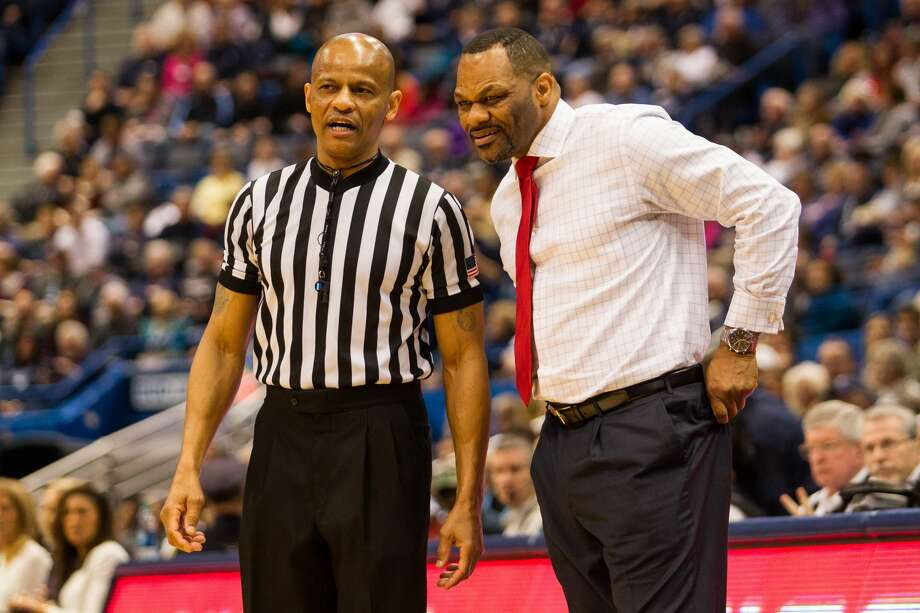 HARTFORD, CT -  Houston Cougar's Head Coach Ronald Hughey  talks with a referee during the first half a women's NCAA division 1 basketball game at the XL Center in Hartford, CT. (Photo by David Hahn/Icon Sportswire via Getty Images) Photo: Icon Sportswire/Icon Sportswire Via Getty Images
