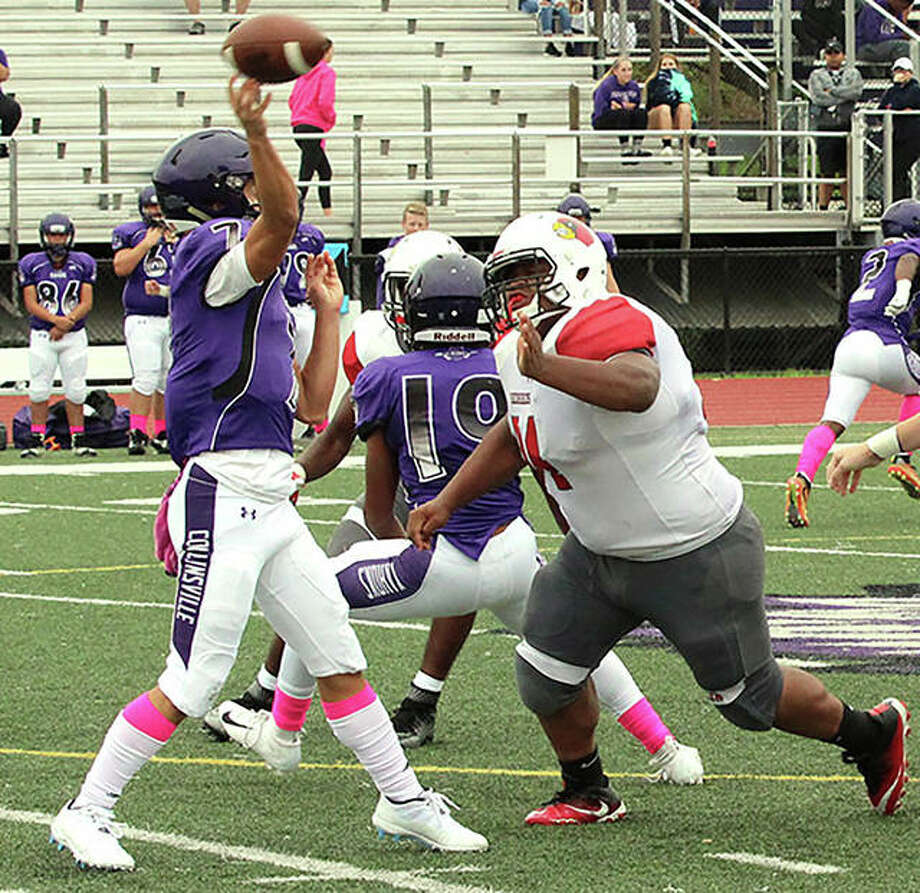 Alton's Kyle Hughes (right), a 5-9, 300-pound junior lineman, applies pressure as Kahoks QB Chris Chi gets off a pass Sept. 8 in Collinsville. Hughes was part of a defensive effort that limited Granite City to 24 yards rushing in Alton's 45-9 victory Friday at Public School Stadium in Alton. Photo: Greg Shashack / The Telegraph
