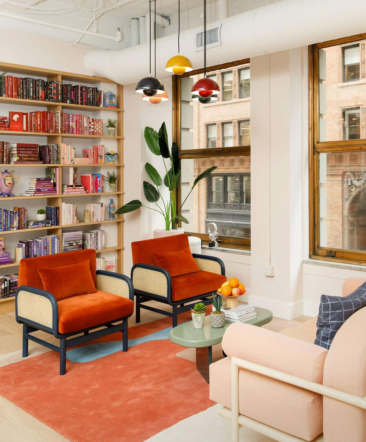 Designed by architect Alda Ly and interior designer Chiara de Rege, the pastel palate synonymous with the Wing's New York and D.C. locations is present in San Francisco but differentiated by rich, warm apricots, mustards and burgundies.
