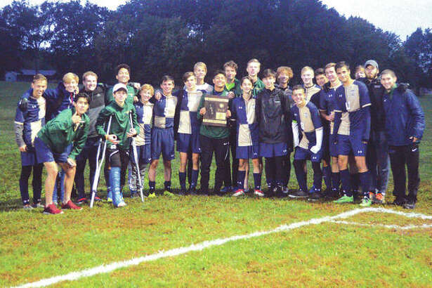 The Father McGivney boys' soccer team poses with the championship plaque after beating East Alton-Wood River 3-1 on Friday in the finals of the Class 1A Greenville Regional.