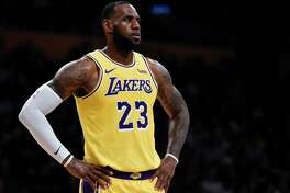FILE - In this Oct. 4, 2018, file photo, Los Angeles Lakers forward LeBron James looks on during the first half of an NBA preseason basketball game against the Sacramento Kings in Los Angeles. The only certainty in the NBA this season is that James won't win the East _ ending an eight-year run of that, four in Miami and four in Cleveland.