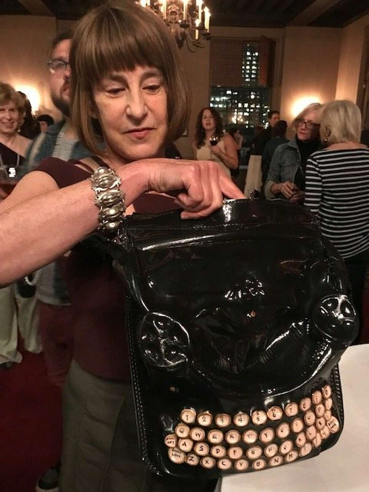 Alexandra Szerlip with typewriter purse, at Litquake opening party