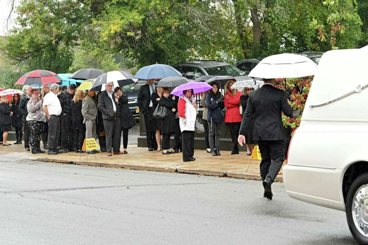 Mourners wait in line before a Mass of Christian Burial held for Schoharie limo crash victims Shane McGowan and Erin (Vertucci) McGowan at St. Mary's Roman Catholic Church on Monday, Oct. 15, 2018 in Amsterdam, N.Y. (Lori Van Buren/Times Union)