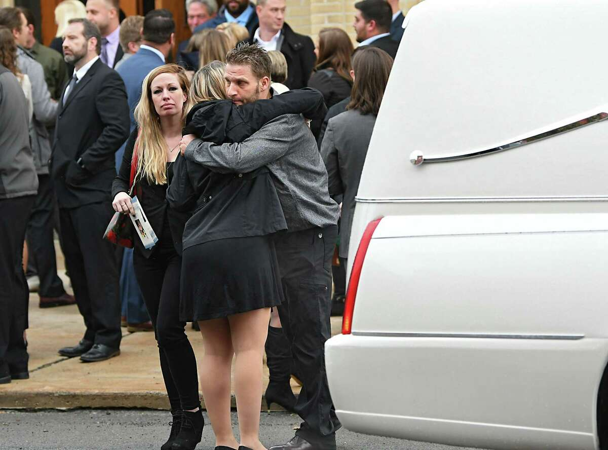 Mourners embrace after a Mass of Christian Burial held for Schoharie limo crash victims Shane McGowan and Erin (Vertucci) McGowan at St. Mary's Roman Catholic Church on Monday, Oct. 15, 2018 in Amsterdam, N.Y. (Lori Van Buren/Times Union)
