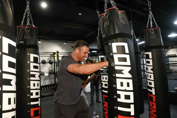 Lou Savarese checks out the heavy bags during the grand opening of Savarese Fight Fit, a boxing gym, in West University Place.