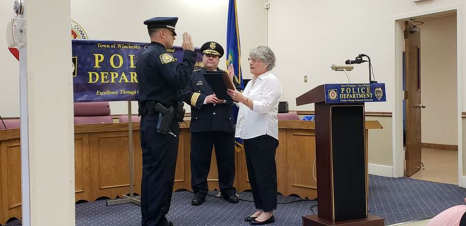John T. Cummings III was sworn in Oct. 11 as the newest member of the Winchester Police Department, joined by Chief William T. Fitzgerald Jr., center, and Town Clerk Sheila Sedlak. Photo: Town Of Winchester / Contributed Photo /