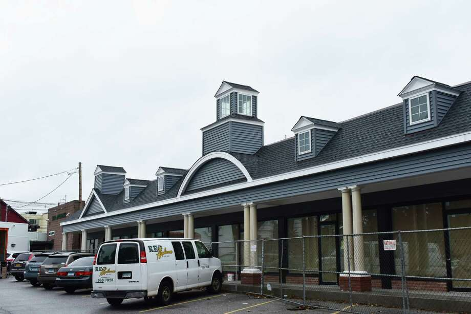 2 Roger Square — Touch-ups continue in mid-October 2018 on the Ludlow Shopping Centre at 2 Roger Square in Norwalk, Conn., nearly three years after the plaza was gutted in a fire that displaced five businesses. Ludlow Shopping Centre totals about 10,000 square feet of space in Norwalk, with the property appraised at $1.3 million by the city of Norwalk prior to the fire. Photo: Alexander Soule, Hearst Connecticut Media / Stamford Advocate