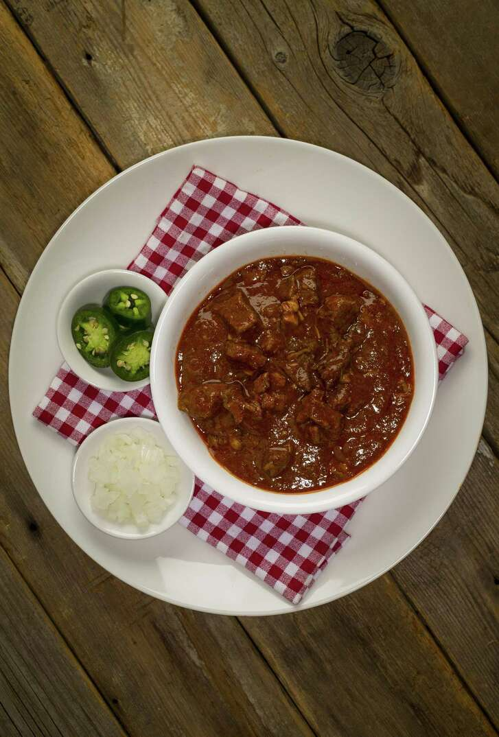 "Chili Queen Chili: Recipe adapted from ""The Chili Cookbook"" by Robb Walsh. It's made with diced beef chuck and pork shoulder simmered in a dried chile paste."