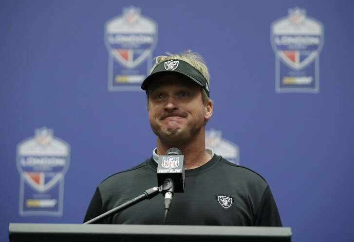 Oakland Raiders head coach Jon Gruden pauses during a press conference after an NFL football game against Seattle Seahawks at Wembley stadium in London, Sunday, Oct. 14, 2018. Seattle Seahawks won the match 27-3. (AP Photo/Matt Dunham)