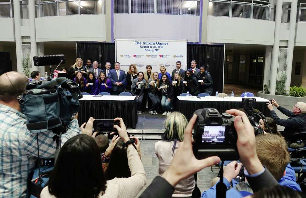 Women athletes from various local colleges pose for a photo with elected officials and organizers of the Aurora Games during a press conference at The Times Union Center on Monday, Oct. 15, 2018, in Albany, N.Y. It was announced at the event that the Aurora Games would be coming to Albany in August of 2019. (Paul Buckowski/Times Union)