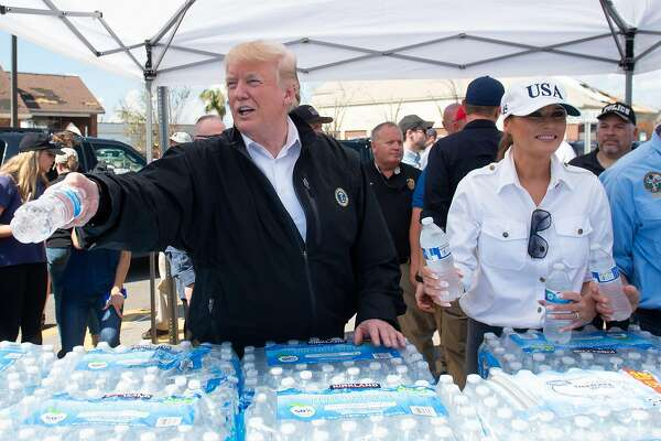 US President Donald Trump and First Lady Melania Trump hand out bottles of water as they tour damage from Hurricane Michael in Lynn Haven, Florida, October 15, 2018. - President Donald Trump visited Florida on Monday, nearly a week after Hurricane Michael slammed the southern US state, where thousands of people are struggling to survive without running water or electricity. Michael smashed into Florida's western coast on Wednesday as a powerful Category 4 storm, packing winds of 155 miles (250 kilometers) per hour as it began a northern march through several states on the United States' southeast coast, killing at least 17 people. (Photo by SAUL LOEB / AFP)SAUL LOEB/AFP/Getty Images