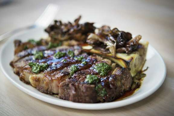 Grilled ribeye Yukon gold potatoes, bone marrow, wild mushrooms and salsa verde at Eunice.