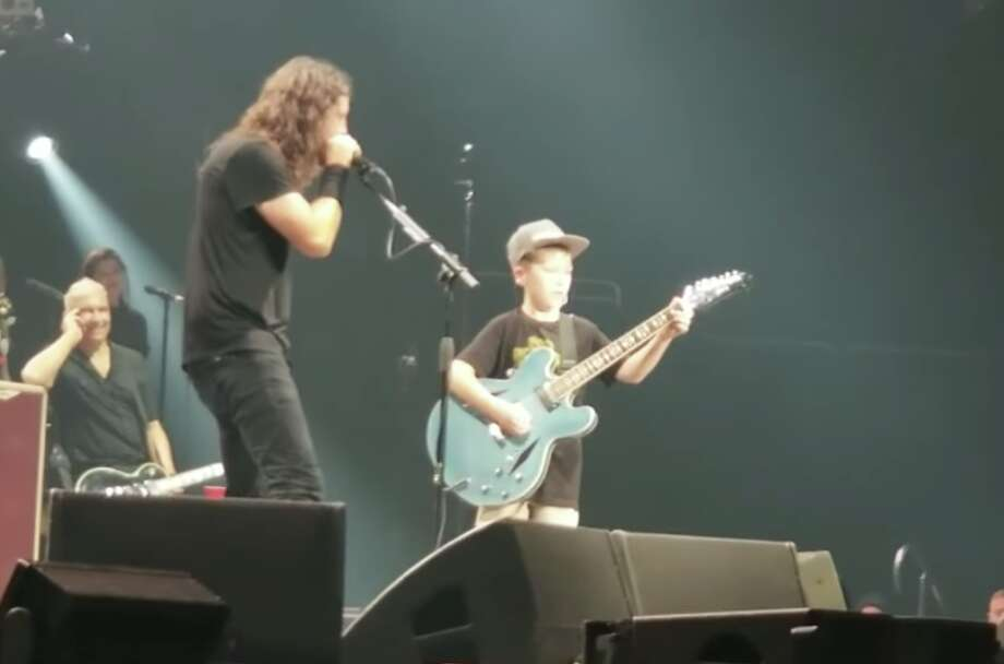 10-year-old boy brought onstage at Foo Fighters show wows crowd with Metallica covers