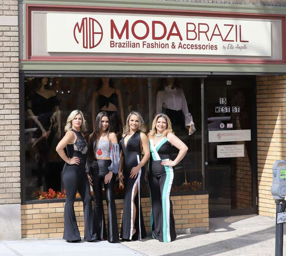 Elisangela de Carvalho, owner of Moda Brazil by Elis Angela, and friends wear Brazilian fashions as they stand outside of Moda Brazil in downtown Danbury, Conn. Photo: Contributed Photo / Hearst Connecticut Media / The News-Times Contributed