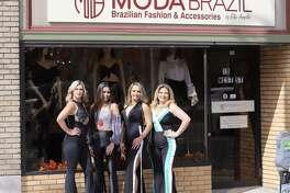 Elisangela de Carvalho, owner of Moda Brazil by Elis Angela, and friends wear Brazilian fashions as they stand outside of Moda Brazil in downtown Danbury, Conn.