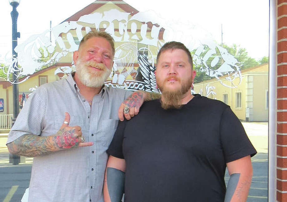 Keith Leatherman and Greg Bushong, Jr. are two of the tattoo artists at Underground Artworks in Edwardsville. The business is celebrating its 20th anniversary. Photo: Carol Arnett/Intelligencer