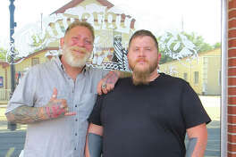Keith Leatherman and Greg Bushong, Jr. are two of the tattoo artists at Underground Artworks in Edwardsville. The business is celebrating its 20th anniversary.