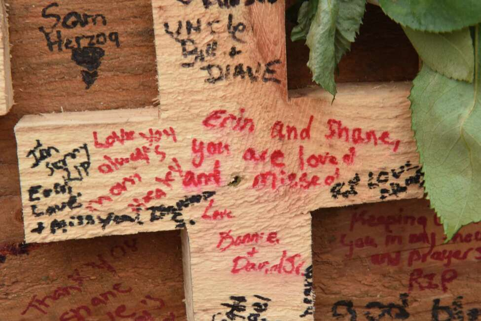 A message to crash victims Erin and Shane are seen on a wooden cross as the memorial for the Schoharie limo crash victims grows at the site of the accident next to the Apple Barrel Store on Monday, Oct. 15, 2018 in Schoharie, N.Y. (Lori Van Buren/Times Union)