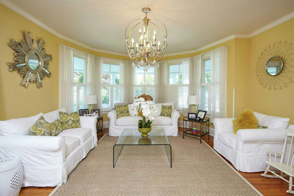 The formal living room is one of 17 rooms in this 5,300 square-foot house.